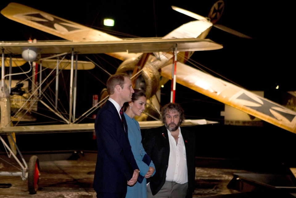 Britain's Prince William, left, and his wife Kate, the Duchess of Cambridge, are guided on a tour of the Omaka Aviation Heritage Centre by film director Peter Jackson, in Blenheim, New Zealand, Thursday, April 10, 2014. (AP / Iain McGregor)