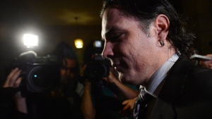 Patrick Brazeau arrives at the Senate on Parliament Hill in Ottawa, Tuesday, Nov. 5, 2013. Brazeau will face charges of assault and uttering threats following his arrest in Gatineau early Thursday morning. (Sean Kilpatrick / THE CANADIAN PRESS)