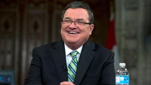 Jim Flaherty speaks during an interview after tabling the budget on Parliament Hill in Ottawa on Tuesday, Feb. 11, 2014. (Justin Tang / THE CANADIAN PRESS)
