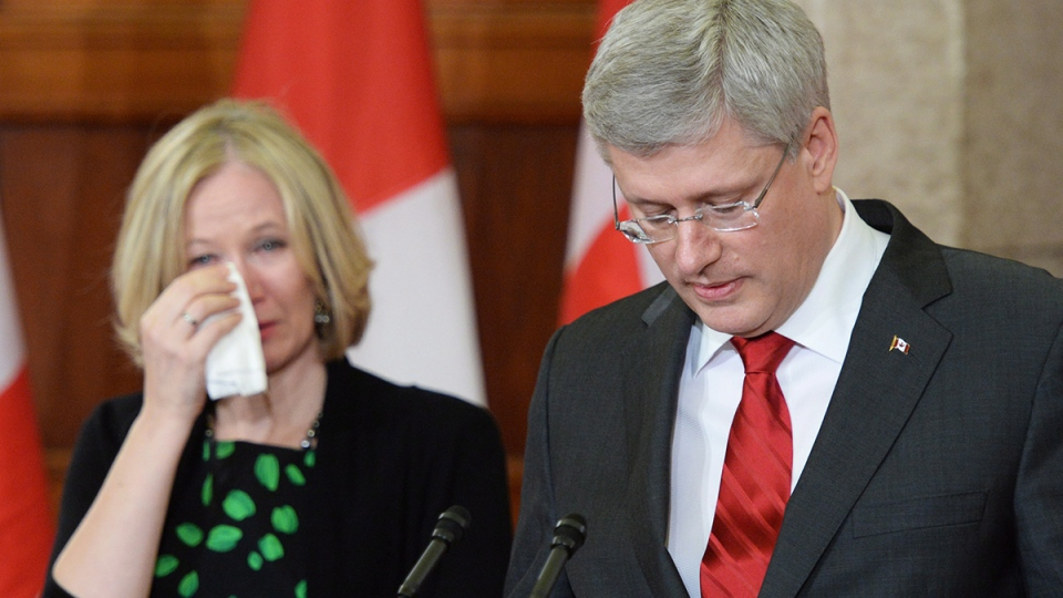 Prime Minister Stephen Harper speaks alongside his wife Laureen following the death of former Finance Minister Jim Flaherty in Ottawa, Thursday, April 10, 2014. (Sean Kilpatrick / THE CANADIAN PRESS)