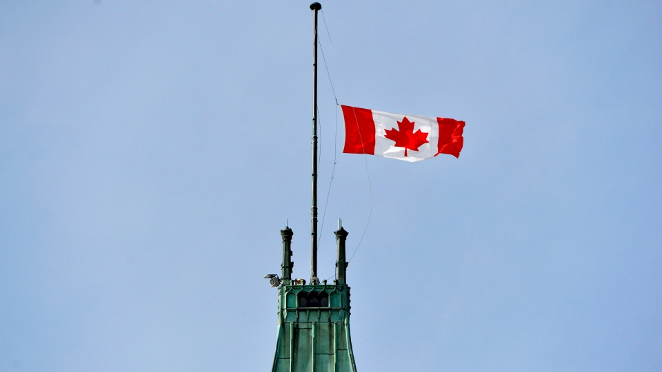 The flag on the Peace Tower flies at half mast in honour of former finance minister Jim Flaherty Thursday April 10, 2014 in Ottawa. Flaherty passed away at the age of 64. (Adrian Wyld / THE CANADIAN PRESS)