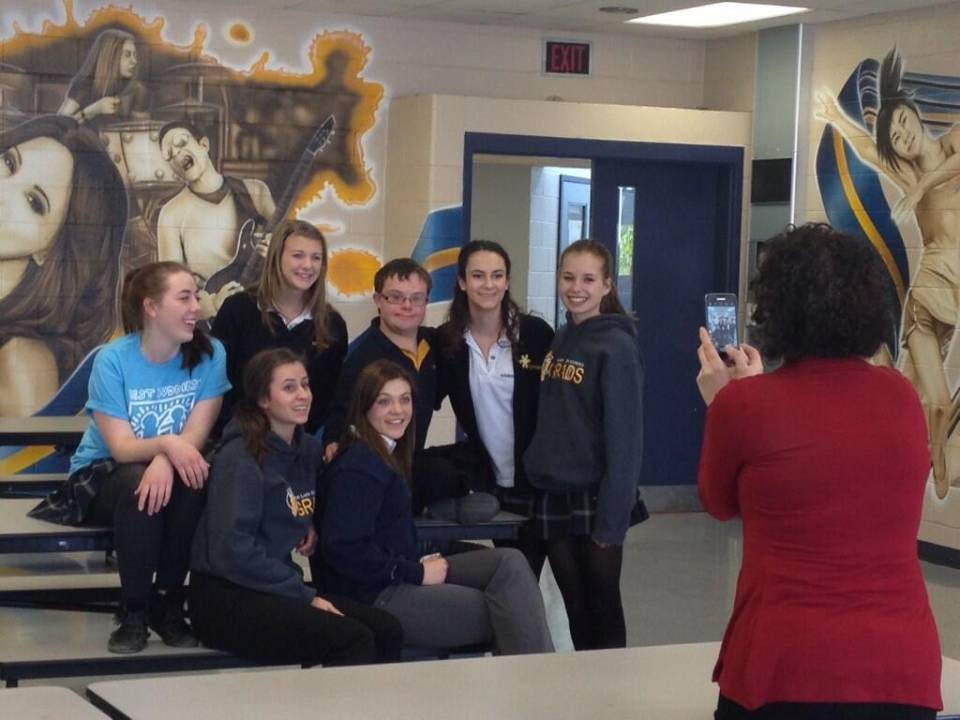 J.D. Kus (back row, centre), Danielle Clayton (to the right of J.D.) and friends pose for a photo at Our Lady of Lourdes Catholic School in Guelph, Ont. (David Imrie / CTV Kitchener)