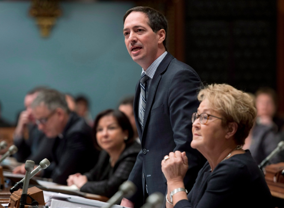 Quebec government legislature Leader Stephane Bedard defends Premier Pauline Marois over allegations of a deal between a company owned by her family and a union leader, Thursday, February 20, 2014 at the legislature in Quebec City. THE CANADIAN PRESS/Jacques Boissinot