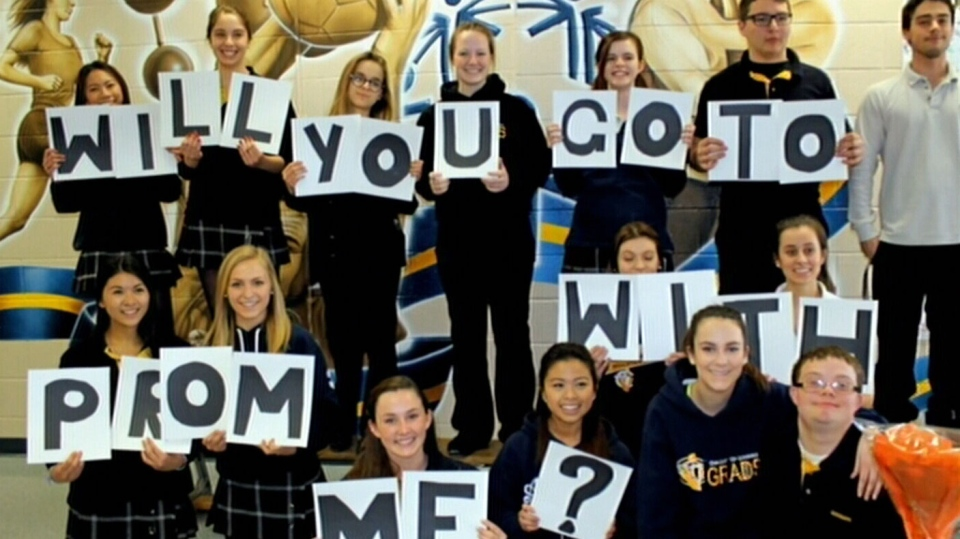 Daniele Clayton and her classmates with their surprise for JD Kus at Our Lady of Lourdes Catholic High School in Guelph, Ont.