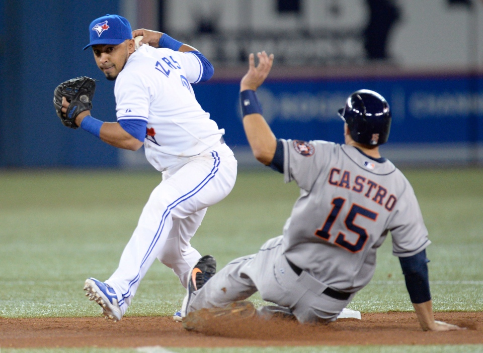 Houston Astros' Jason Castro slides into second for the out as Toronto Blue Jays' Maicer Izturis looks towards first base during fourth inning AL baseball action in Toronto on Thursday April 10, 2014. (Frank Gunn / THE CANADIAN PRESS)