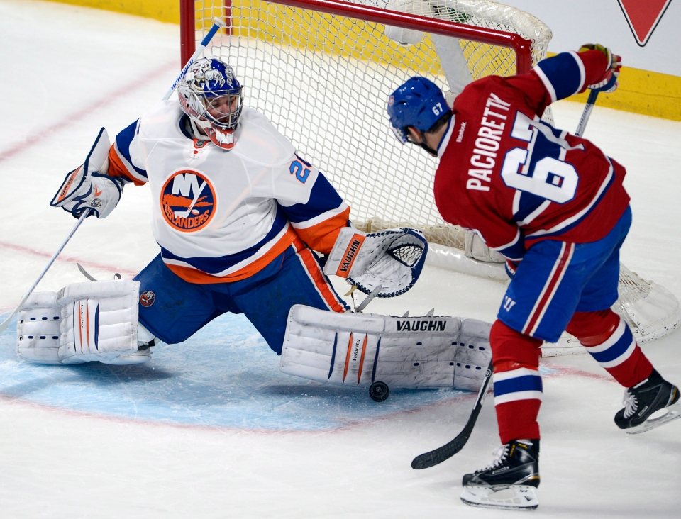 New York Islanders goalie Evgeni Nabokov (20) stops Montreal Canadiens left wing Max Pacioretty (67) during second period NHL action Thursday, April 10, 2014 in Montreal.THE CANADIAN PRESS/Ryan Remiorz