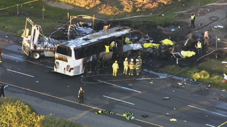 Emergency crews at the scene of a deadly crash in northern California, Thursday, April 10, 2014.