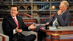 Stephen Colbert, left, host of the 'Colbert Report' on the Comedy Central Network, has a laugh on stage with host David Letterman on the set of the 'Late Show with David Letterman,' in New York May 3, 2012. (CBS, John Paul Filo)