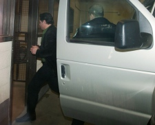 Patrick Brazeau is escorted into the Gatineau Cour