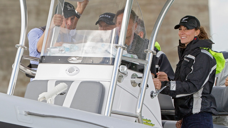 Britain's Prince William, left, and his wife, Kate, the Duchess of Cambridge travel by Sealegs craft to Westpark Marina in Auckland, New Zealand, Friday, April 11, 2014. (AP Photo/SNPA, David Rowland, Pool)