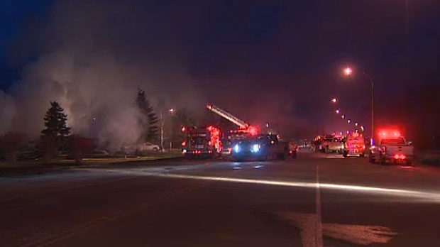 Two people were injured in a huge blaze in Penhold that tore through an apartment building. Investigators are looking into the cause of the fire.