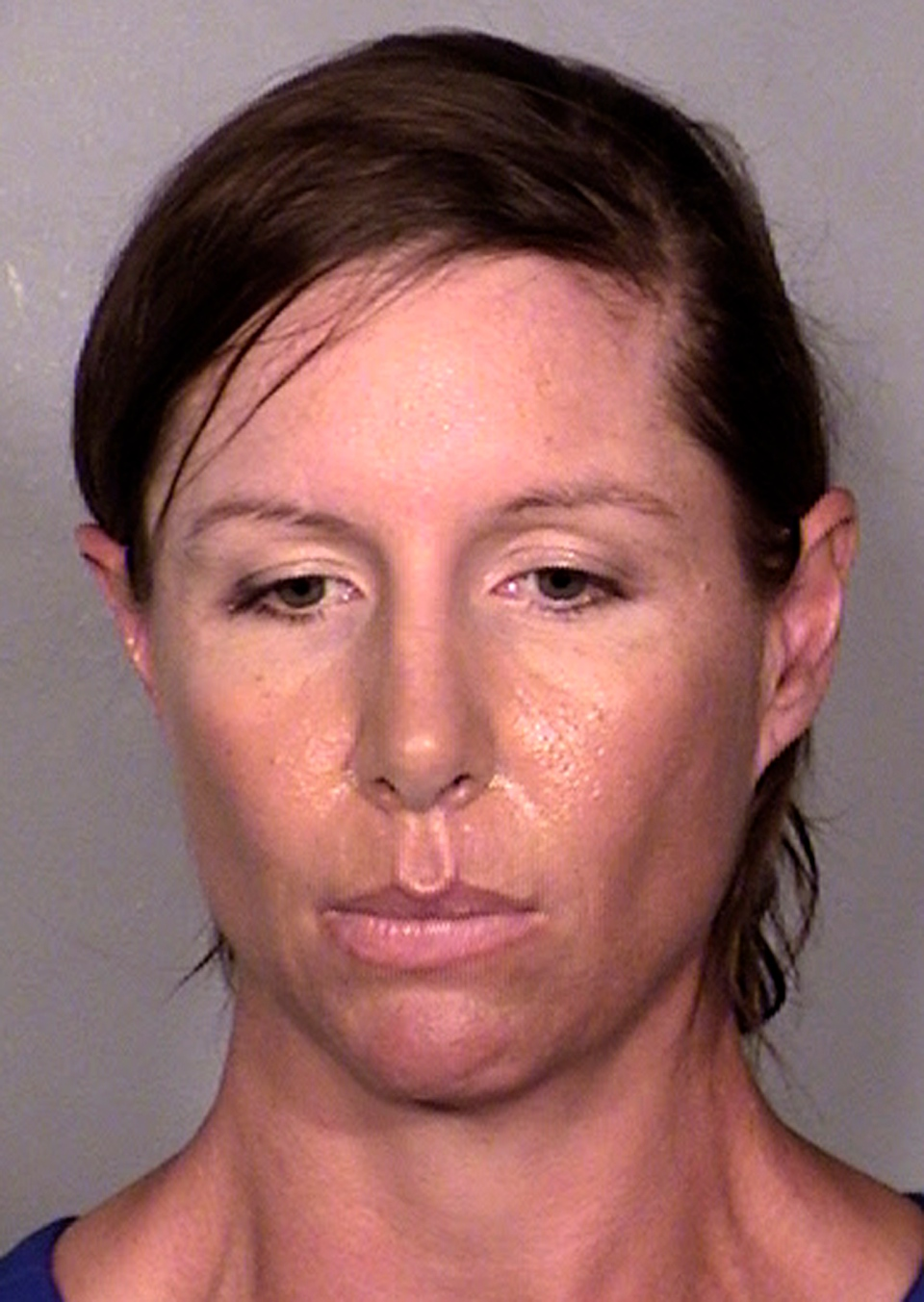 Alison Ernst, who was arrested on April 10, 2014 in connection with an incident involving throwing a shoe at Former Secretary of State and Former First Lady Hillary Clinton, is shown in this image provided by the Last Vegas Metropolitan Police Department.