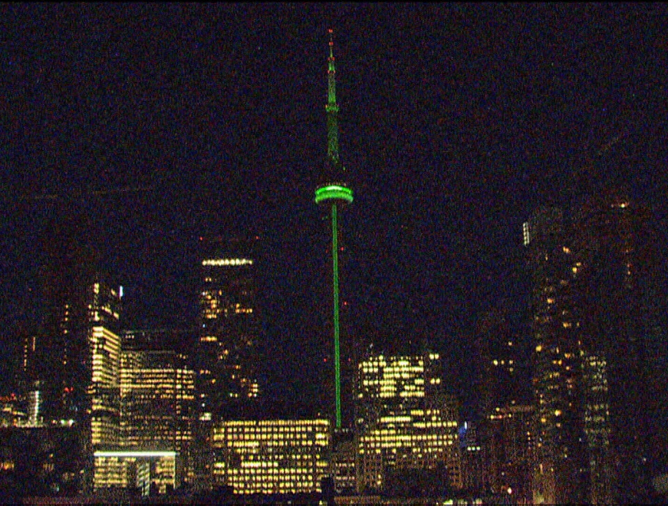 CN Tower lit up green in honour of the late Jim Flaherty in Toronto, Ont. on Friday, April 11, 2014.