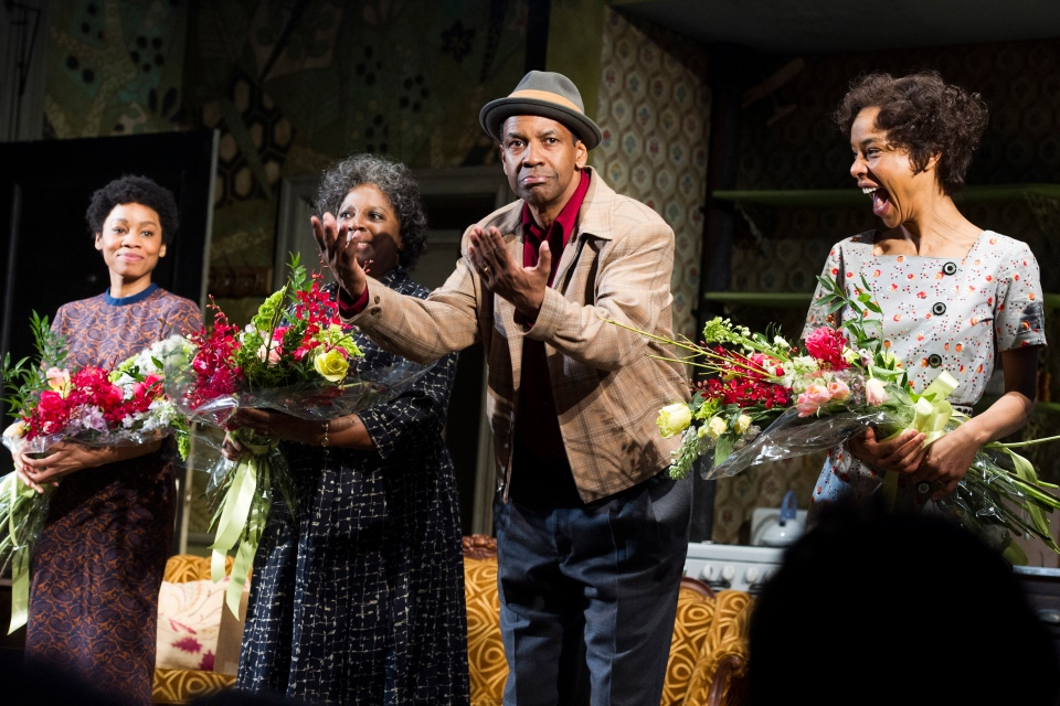 From left, Anika Noni Rose, LaTanya Richardson, Denzel Washington and Sophie Okonedo at the curtain call for the opening night of 'A Raisin In The Sun' in New York on April 3, 2014. (Invision / Charles Sykes)