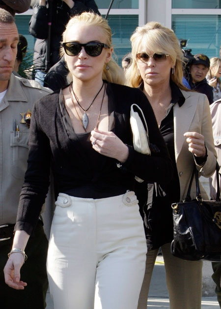 Lindsay Lohan, followed by her mother Dina, leaves Los Angeles Superior Court on Wednesday, Feb. 23, 2011. (AP / Reed Saxon)