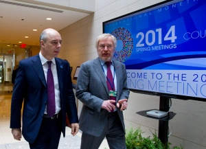 Russian Finance Minister Anton Siluanov, left, and Russian Deputy Finance Minister Sergei Storchak walk to the G20 finance ministers and central bank governors meeting on the sidelines of their meeting at World Bank Group-International Monetary Fund Spring Meetings in Washington on Friday, April 11, 2014. (AP/Jose Luis Magana)