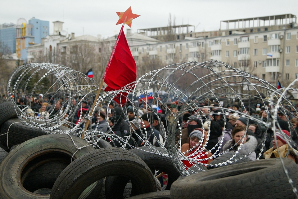 A red flag is placed on top a barricade at the regional administration building in Donetsk, Ukraine on Saturday April 12, 2014. (AP / Alexander Ermochenko)