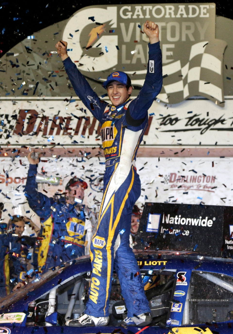 Chase Elliott celebrates in Victory lane after winning a NASCAR Nationwide series auto race at Darlington Speedway in Darlington, S.C., Friday, April 11, 2014. (AP / Chuck Burton)