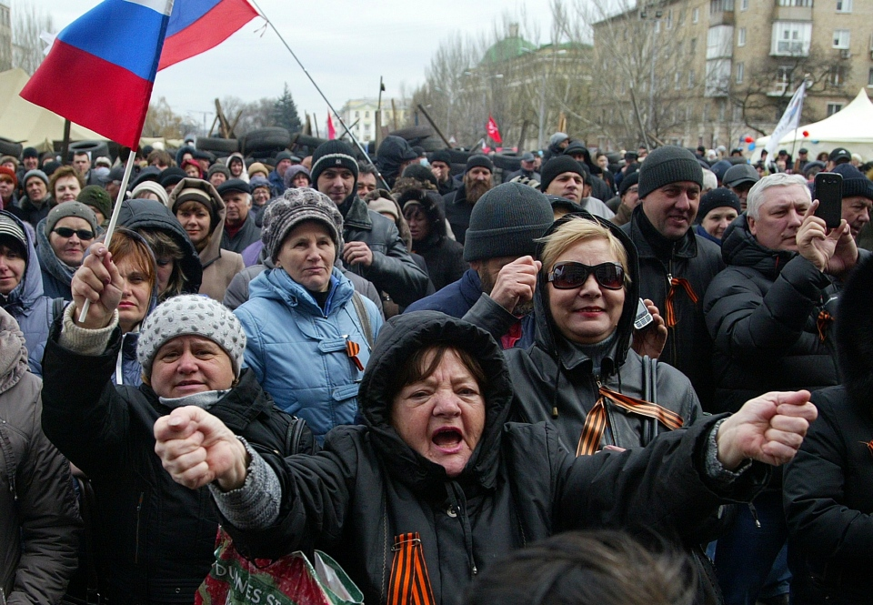 Pro-Russian protesters holding Russian flags gather at the regional administration building in Donetsk, Ukraine, Saturday, April 12, 2014. (AP / Alexander Ermochenko)