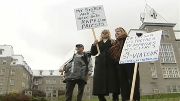 Margot Bussiere (centre) and some supporters hold picket signs outside College Bourget on Friday.