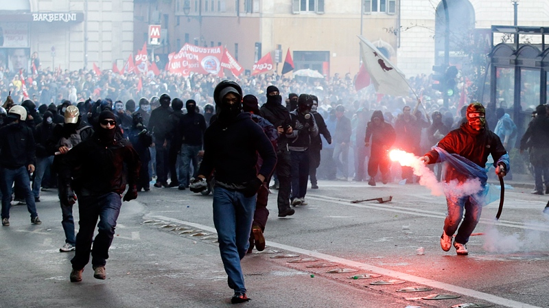 Demonstrators clash with police during an anti-austerity demonstration in Rome, Saturday, April 12, 2014. (AP Photo/Gregorio Borgia)