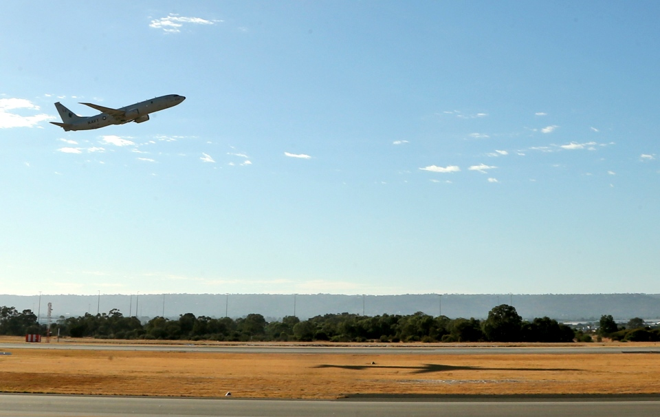 A U.S. Navy P8 Poseidon takes off from Perth Airport en route to rejoin the ongoing search operations for missing Malaysia Airlines Flight 370 in Perth, Australia, Sunday, April 13, 2014. (AP / Rob Griffith)