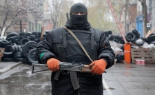 A pro-Russian gunman stands guard
