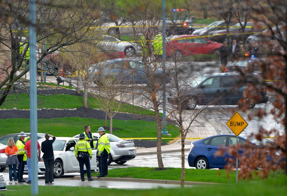 Kansas State Troopers stand near the location of a shooting at the Jewish Community Centre in Overland Park, Kan., on Sunday, April 13, 2014. (The Kansas City Star/John Sleezer)