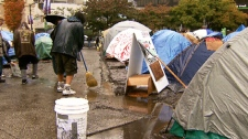 Tarps are thrown over Occupy Vancouver tents during a rainstorm on Oct. 21, 2011. (CTV)