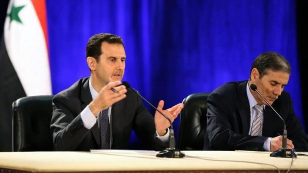 Syrian President Bashar Assad, left, in Damascus