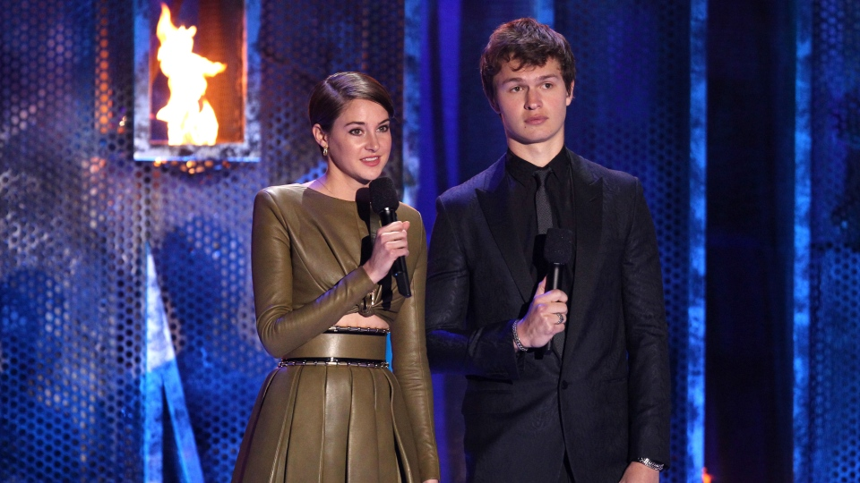 Shailene Woodley, left, and Ansel Elgort introduce a performance by Twenty One Pilots at the MTV Movie Awards on Sunday, April 13, 2014, at Nokia Theatre in Los Angeles. (Matt Sayles/Invision/AP)