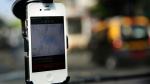 A smartphone is mounted on the glass of an Uber car in Mumbai, India, on April 3, 2014. (AP / Rafiq Maqbool)