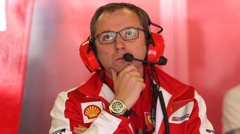 In this Friday, May 10, 2013 file photo, Ferrari team principal Stefano Domenicali watches from the pits during the second free practice session at the Catalunya racetrack in Montmelo, near Barcelona, Spain. (AP Photo/Luca Bruno, Files)