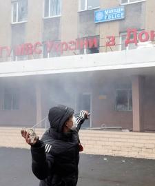 Pro-Russian man throws stone