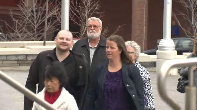 Flanked by supporters, Jacqueline Lavigne is seen walking into the Kitchener courthouse on Monday, April 14, 2014.