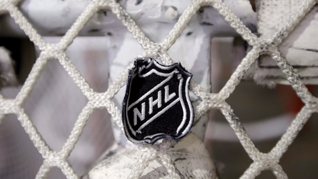 In this file photo taken Sept. 17, 2012, the NHL logo is seen on a goal at a Nashville Predators practice rink in Nashville, Tenn. (AP Photo/Mark Humphrey)