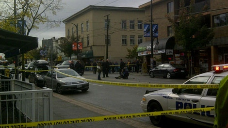 Vancouver police arrest a suspect who was seen brandishing a machete on Commercial Drive Saturday morning. Oct. 22, 2011. (CTV)