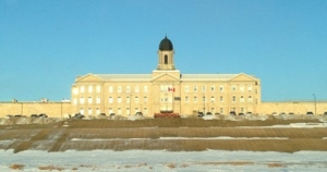 A prisoner is back behind bars at Manitoba's Stony Mountain Institution after a brief escape in Winnipeg on Thursday afternoon.