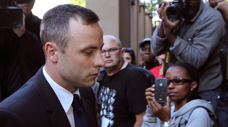 Oscar Pistorius, arrives at the high court in Pretoria, South Africa, Tuesday, April 15, 2014. (AP Photo/Themba Hadebe)