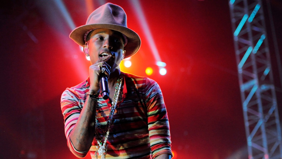 Pharrell Williams performs at the 2014 Coachella Music and Arts Festival on Saturday, April 12, 2014, in Indio, Calif. (Photo by Chris Pizzello / Invision / AP)