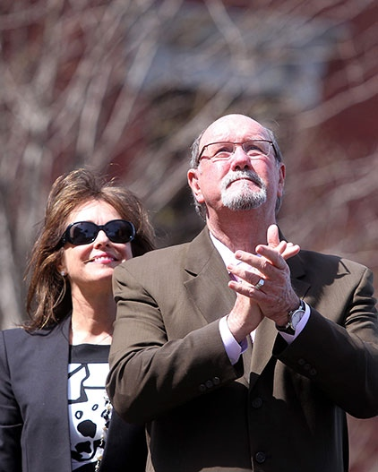 Boston Marathon bombing survivor John Odom stands with his wife Karen during a flag raising ceremony at Boston Medical Center on Monday, April 14, 2014. (AP / The Herald, Matt Stone)