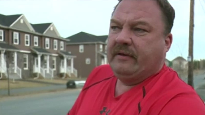 An emotional Patrick McGowan spoke exclusively with CTV News Monday evening and ripped up a large pile of cheques on camera. (CTV Atlantic)