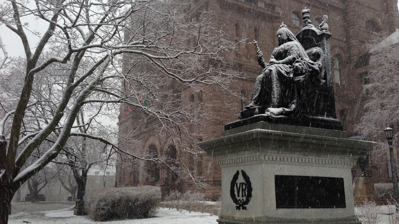 Snow falls on a statue of Queen Victoria at the Ontario legislature on Tuesday, April 15, 2014. (George Stamou / CTV News)