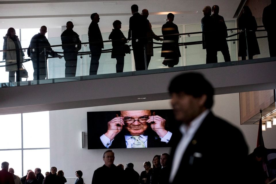Mourners queue to pay their respects at the visitation for Jim Flaherty in Whitby, Ont., on Tuesday, April 15, 2014. The former federal finance minister died suddenly in Ottawa last week. (Chris Young/THE CANADIAN PRESS)
