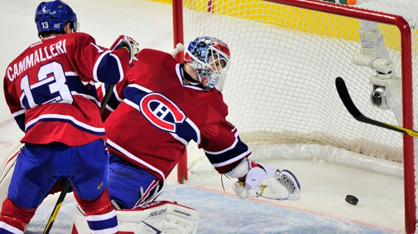 Montreal Canadiens goalie Peter Budaj and Mike Cammalleri watch the puck go into the net on a goal by Florida Panthers' Tomas Fleischmann during first period NHL hockey action Monday, October 24, 2011 in Montreal. THE CANADIAN PRESS/Paul Chiasson
