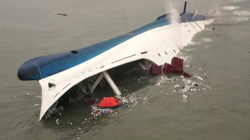 A ferry sinks in the water off the southern coast near Jindo, south of Seoul, Wednesday, April 16, 2014. (South Korea Coast Guard / Yonhap)