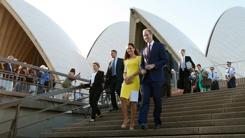 Britain's Prince William, centre right, and his wife Kate, the Duchess of Cambridge, walk down the steps of the Sydney Opera House following a reception in Sydney, Australia, Wednesday, April 16, 2014. (AP Photo/Jason Reed, Pool)