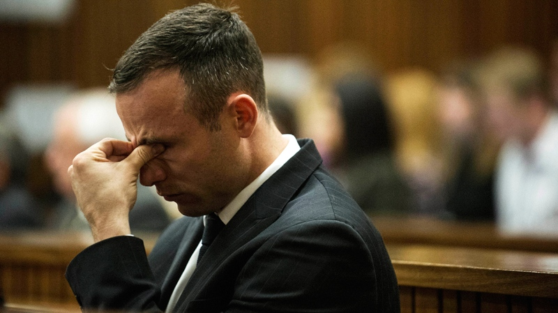 Oscar Pistorius reacts as he listens to forensic evidence being given in court in Pretoria, South Africa, Wednesday, April 16, 2014. (AP / Gianluigi Guercia)