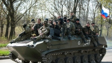 Combat vehicles in Ukraine with Russian flags