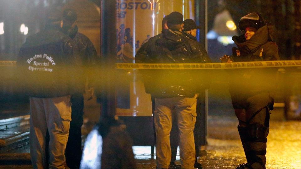 bebbec3a3cce Bomb squad in Boston. Police confer near the finish line of the Boston  Marathon ...
